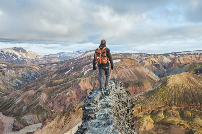 A man hiking in Landmannalaugar on his backpacking trip in Iceland