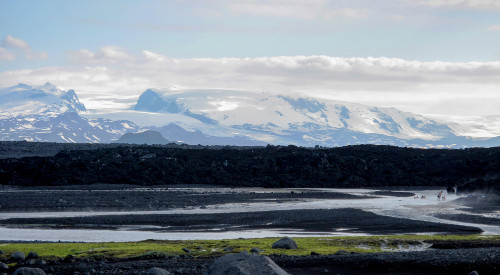 An amazing view on Holuhraun lava field with the Vatnajokull glacier in the background