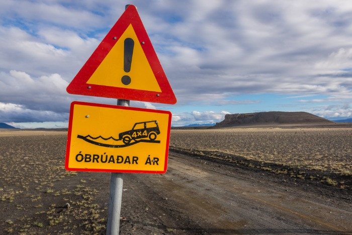 An Icelandic road side on F-road warning that you are approaching a river with no bridge and that 4x4 is necessarythat the