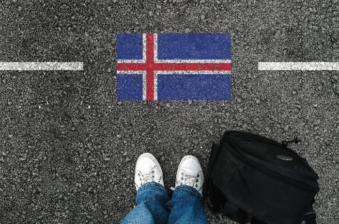 A male tourist at the border ready to enter Iceland.