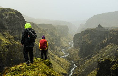 Tourists trekking on one of the best hiking trails in Landmannalaugar