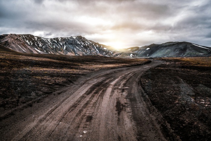 An F-road in the Iceland's Highlands with the mountains covered with snow in the background