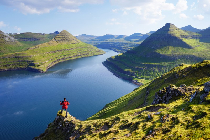 Plan a trip to Faroe Islands from Iceland; the view over the landscapes of the Faoe Islands
