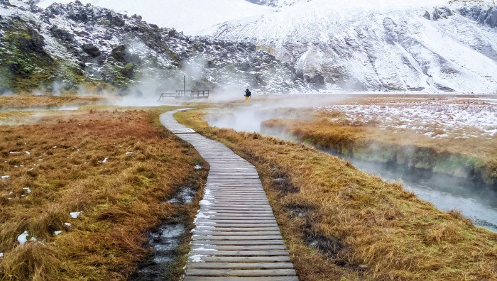 A steam floating over the natural hot spring of Landmannalaugar in early winter