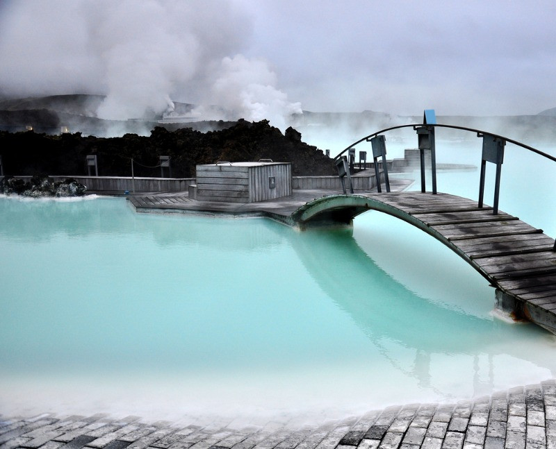 A wooden bridge dividing the Blue Lagoon in Iceland
