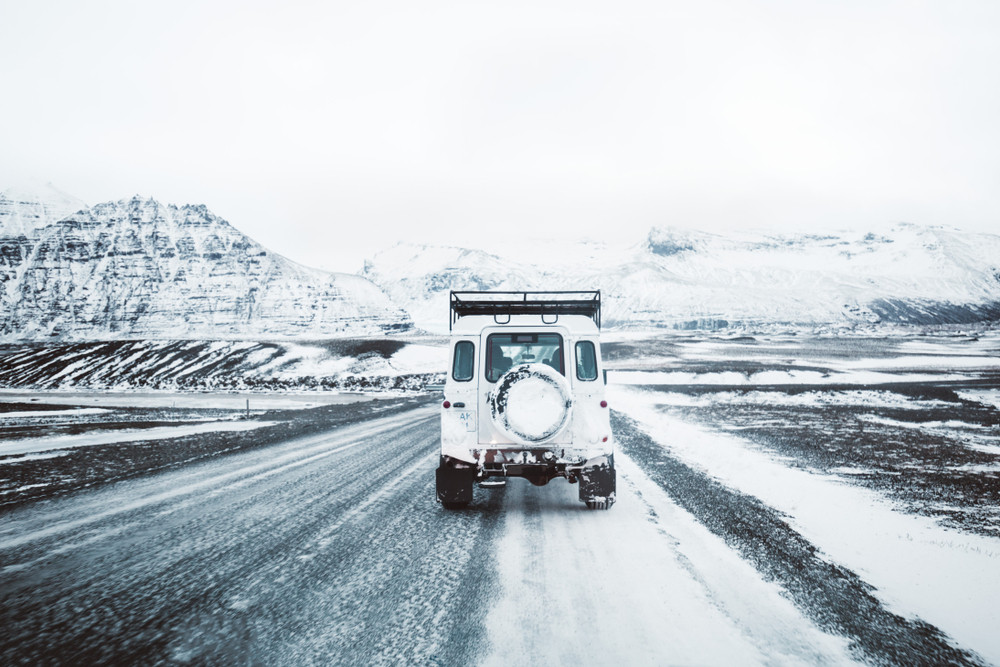 A camper van driving on snowy roads in Iceland worry free because it has the best car insurance