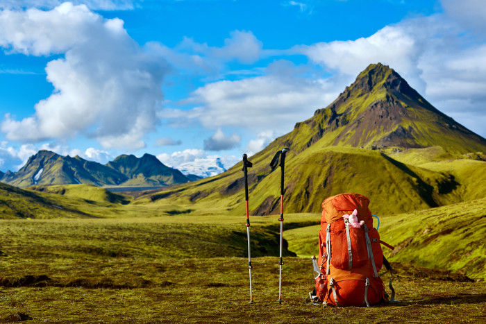Trekking poles and a backpack prepared for hiking in Landmannalaugar