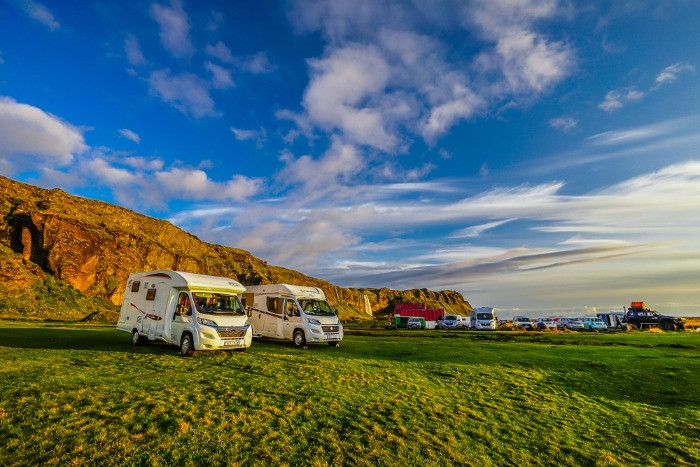 Two motorhomes parked on a campsite in Iceland in a beautiful sunny day
