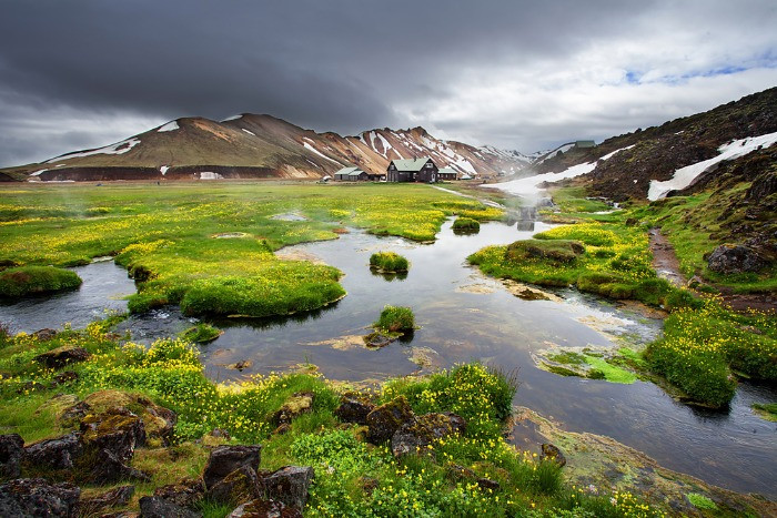 Natural hot spring of Landmannalaugar in early spring with the cloudy, dark sky