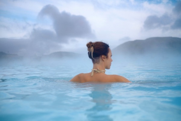 A women tourist relaxing in one fo the hot springs in Iceland