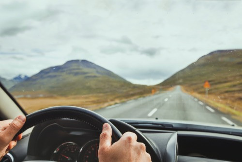 A tourist travelling solo in Iceland on Icelandic Ring Road