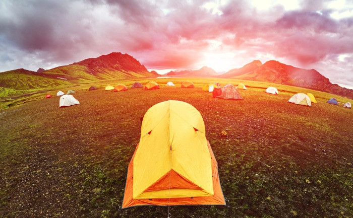 Tourists camping in Iceland in a beautiful scenery campsite according to the right to ram law