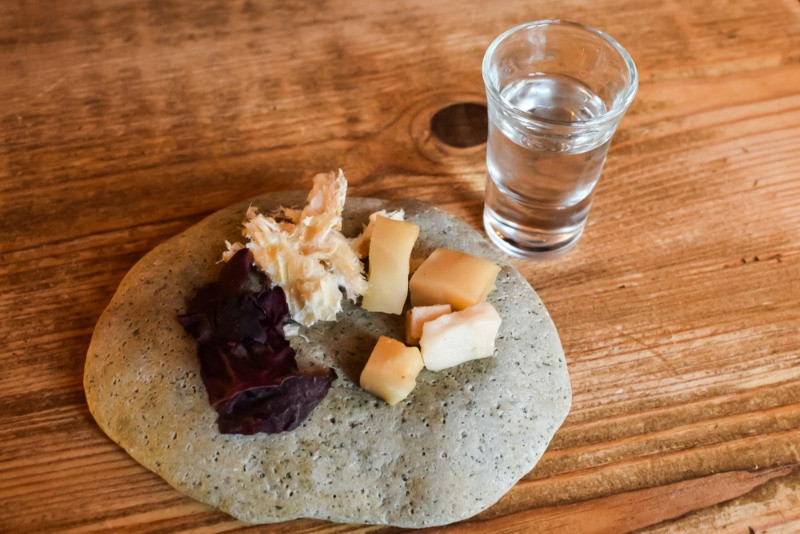 Hakarl Icelandic fermented shark as a side with a shot of vodka