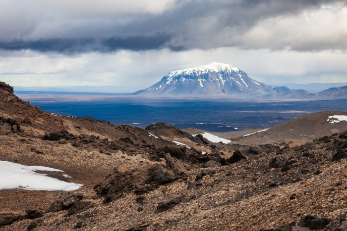 A view on a Herdubreid mountain in a stormy day from Askja volcano