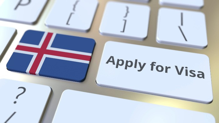 A keybord with a special botton for applying for a visa to travel to Iceland