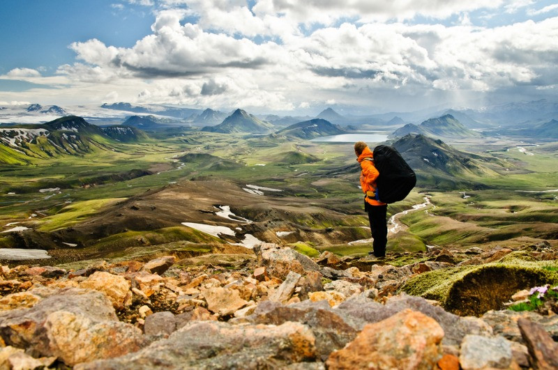 A male tourist who travel solo in Iceland doing a trekking in Landmannalaugar