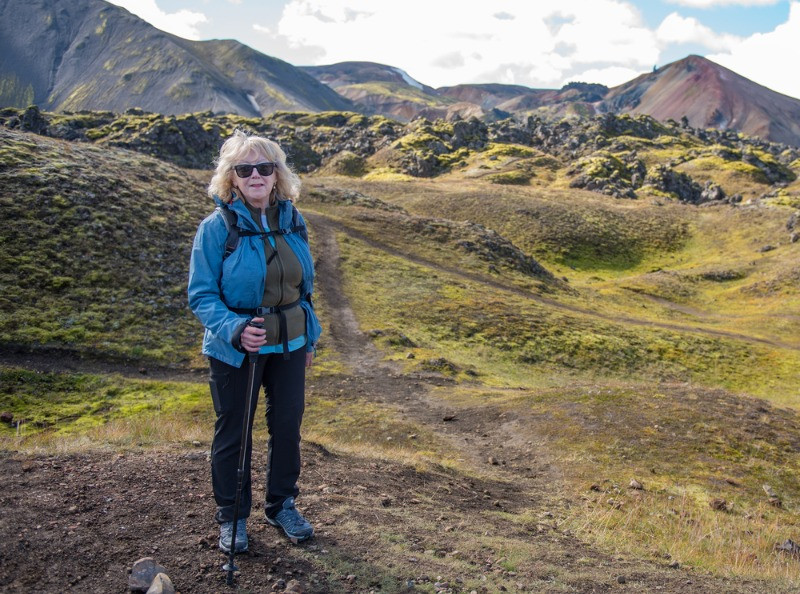 A woman taking hiking tours in Iceland for seniors