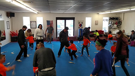 Parents and Students enjoying a game of Belt Sparring in Zeeland Rec My Kids class.