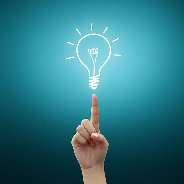 Bulb light on women Fingertip on blue ba