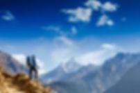 Happy hiker winning reaching life goal,