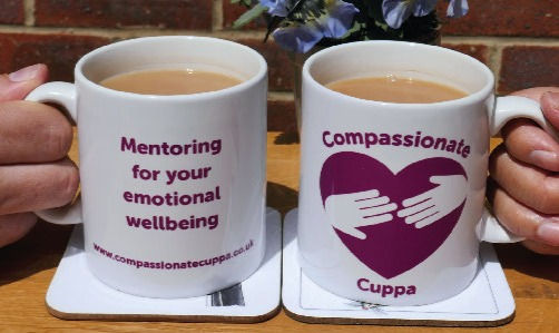 A pair of Mugs with Compassionate Cuppa Logo