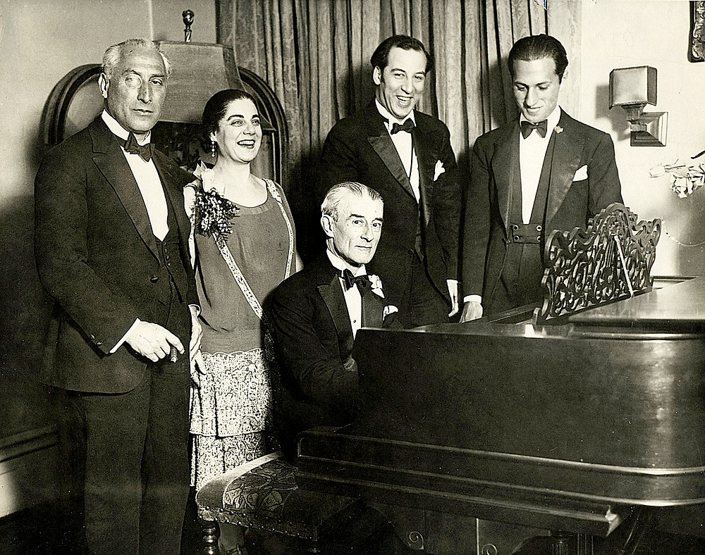 Gershwin (far right) Maurice Ravel at the piano