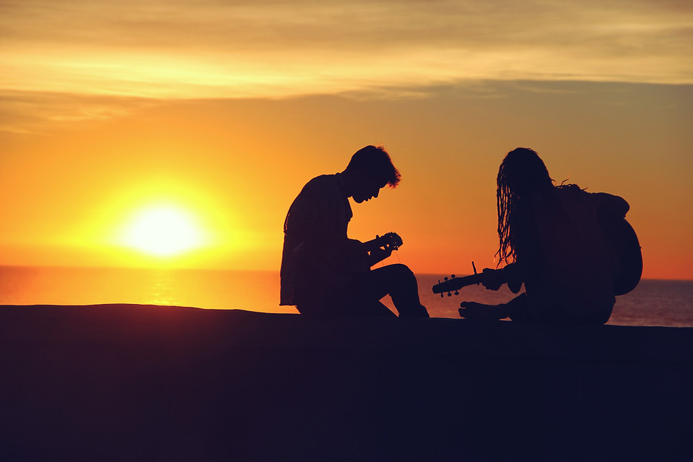 Singing and Playing together at sunset