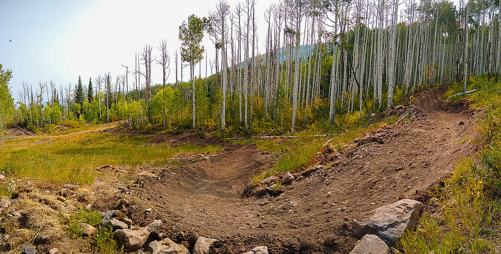 mountain bike berm with aspen trees in background powderhorn resort