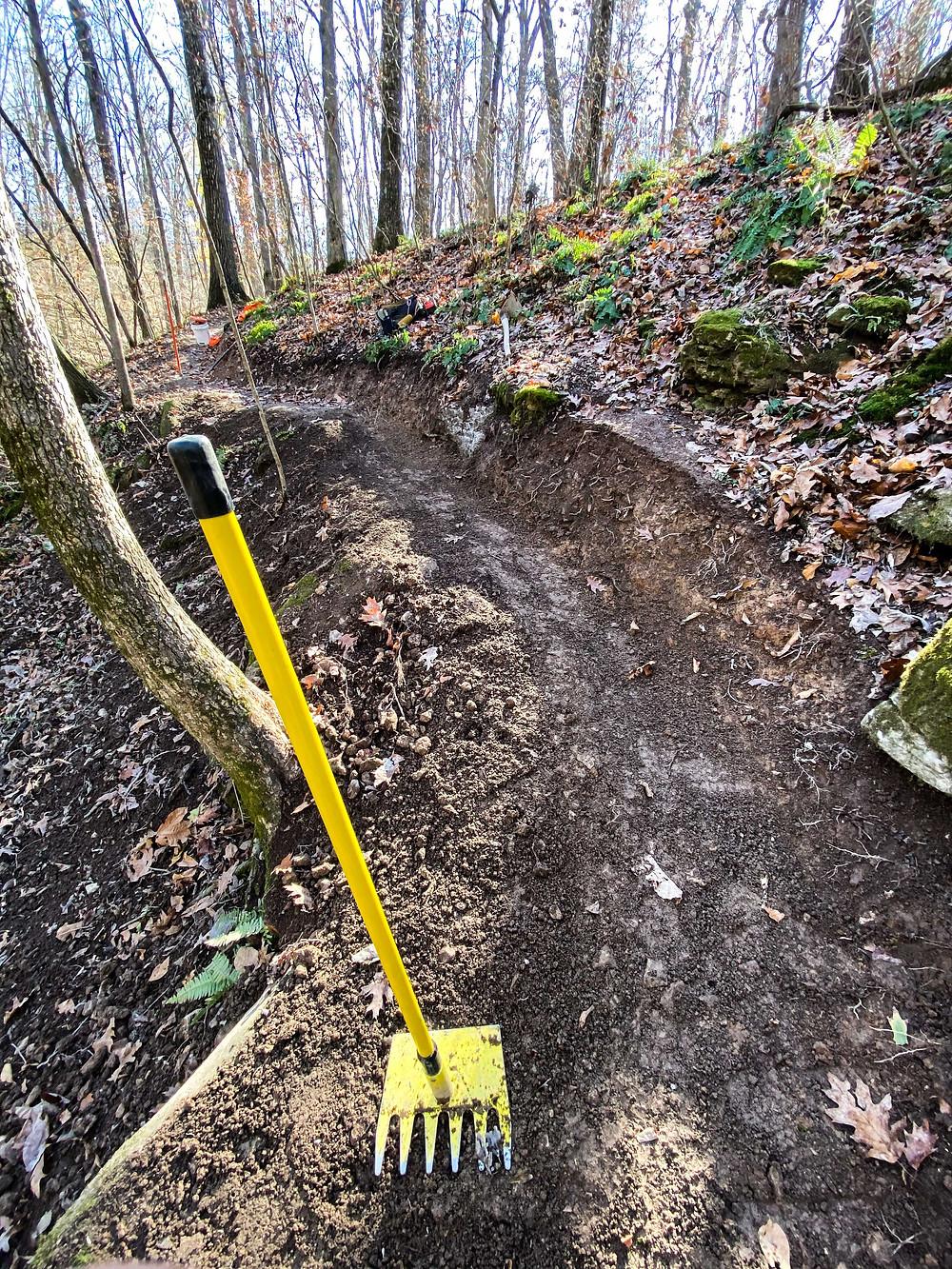 mcleod trailbuilding tool resting on freshly cut trail