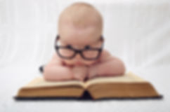 funny portrait of cute  baby in glasses