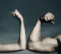 Muscular arm vs weak hand. Vs, fight har