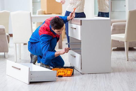 Contractor repairman assembling furnitur