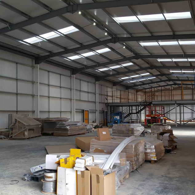 New industrial unit near Bat and Ball Station for Travis Perkins