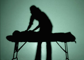manual therapy image in silhouette