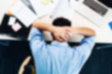stressed man at desk.jpg