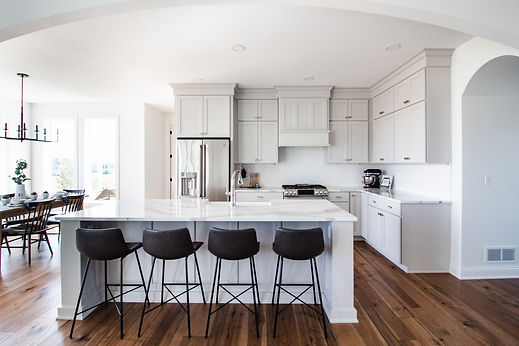 2019 Parade of Homes house kitchen. Island with 4 stools. Dining room.