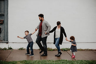 family-of-four-walking-at-the-street-225