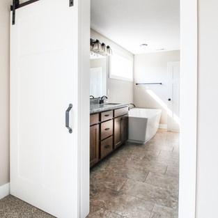 Aldrin Avenue Master Bathroom Barn Door