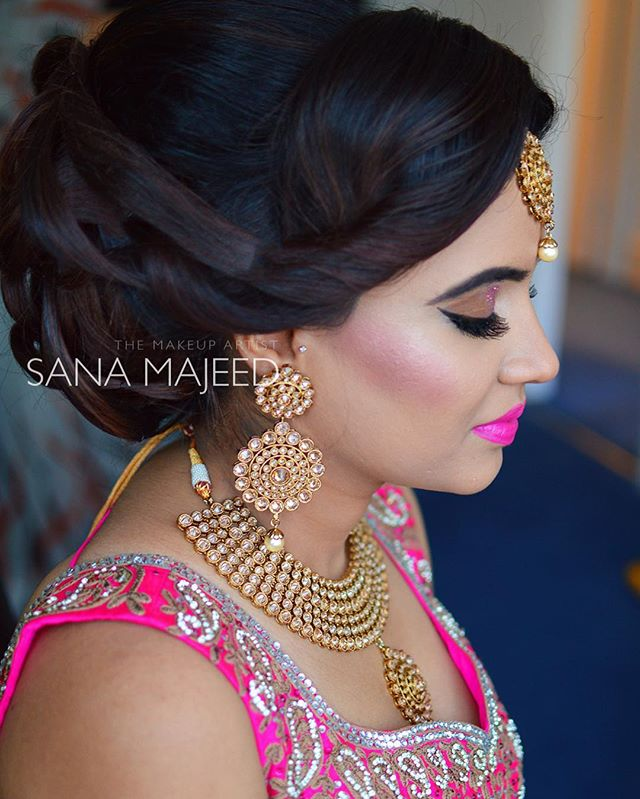 Low, elegant and intricate bun on the lovely Sonia. She looks picture perfect