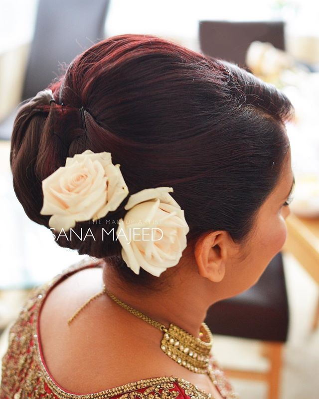Love the red tones in my clients hair. And also, I'm a bit obsessed wth using flowers in updo's at t
