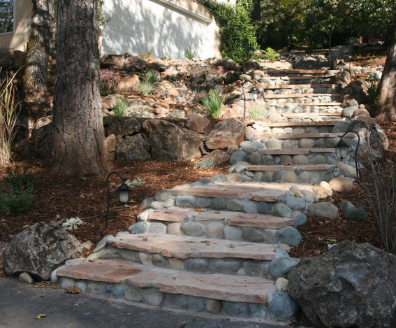 Repurposing existing river rock to improve stairs