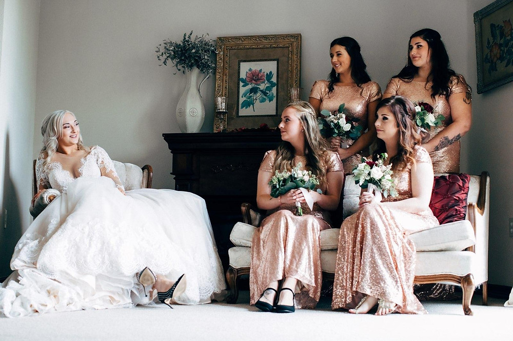 Bride sitting with bridesmaids