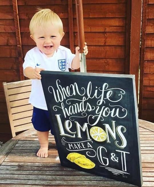 Little boy holding blackboard