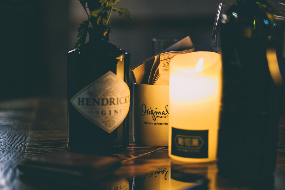 Bottle of Hendrick's gin with candle