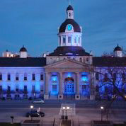A photo of the Kingston, Ontario court house lit up in blue as a sign of solidarity and support for medical per-sonnel, and front line responders , and those fighting the Covid19 pandemic. Photo courtesy Sandy Berg