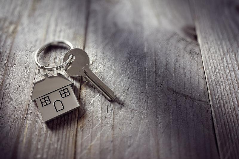 House key on a house shaped keychain res