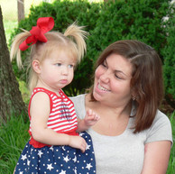 Addilyn Couch, 2, is dressed in her best patriotic dress Monday with her mom, Leah Couch.
