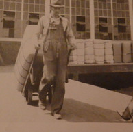 Carl Scott wheels a bale of raw material into Brighton's warehouse - 1946