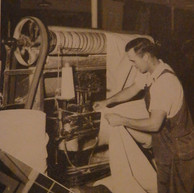 Clarence Lee Wright operates a shearer in the cloth room - 1946