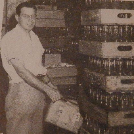 Dope Wagon - Larry Brown in a well supplied storeroom. 1947